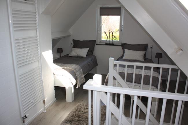 De ruime slaapkammer van Bed & breakfast Magnolia